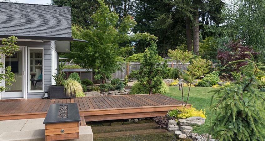 Deck over a stream in backyard