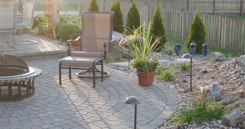 paver patio with plantings and firepit