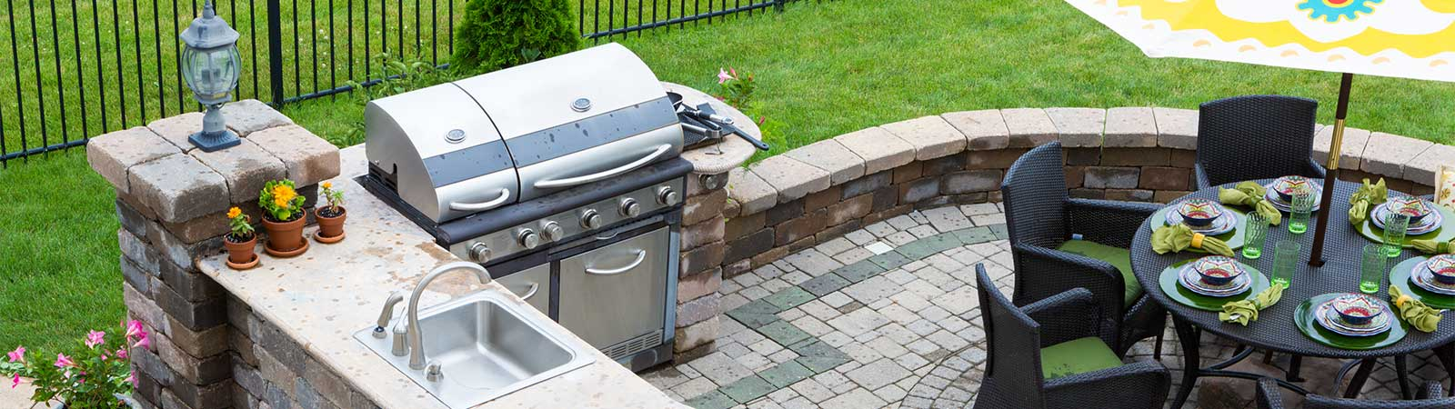 outdoor kitchen with grill and table