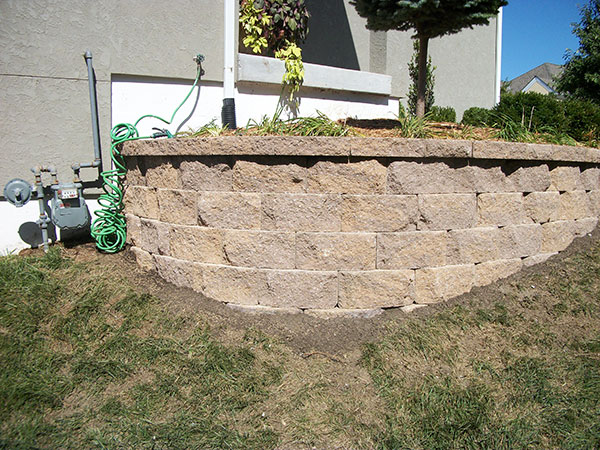 Retaining wall creating landscaping spaces
